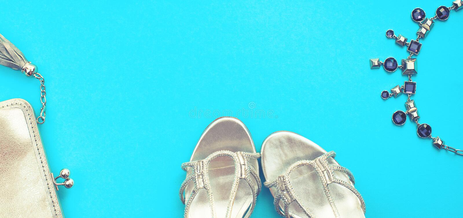 Banner Set of fashion accessories flat lay shoes handbag necklace jewelry silver color on blue background Top view copy space royalty free stock photos