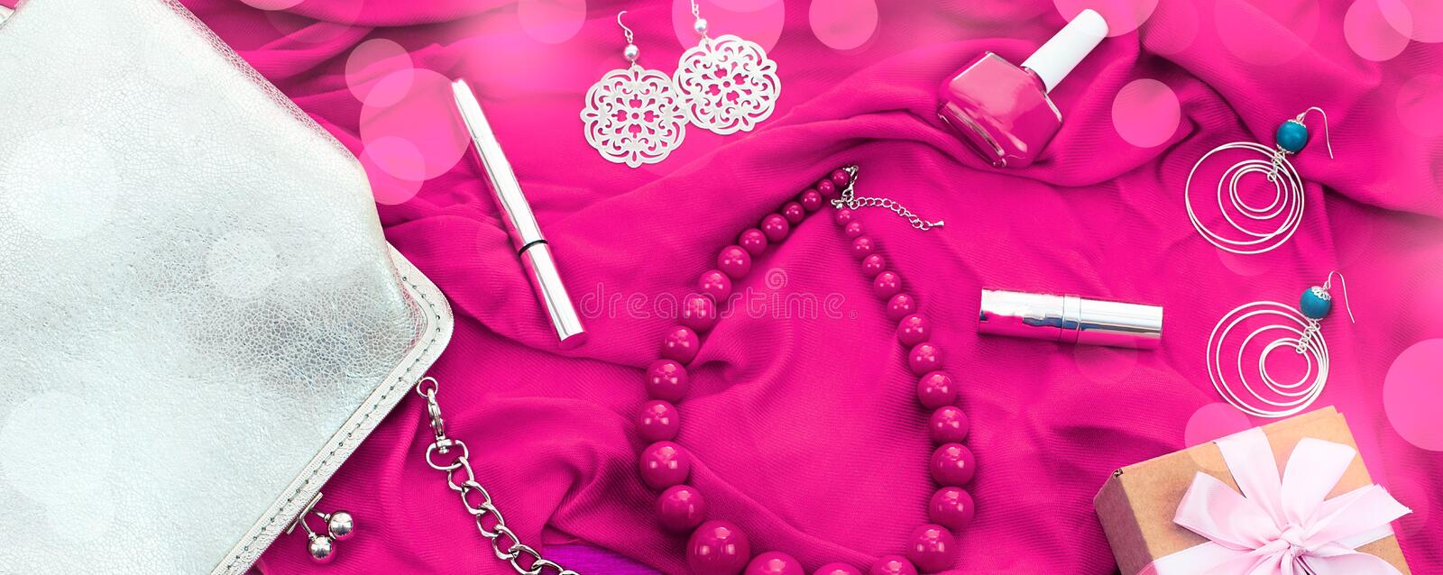 Banner set of women`s accessories and cosmetics on a pink background. stock photo