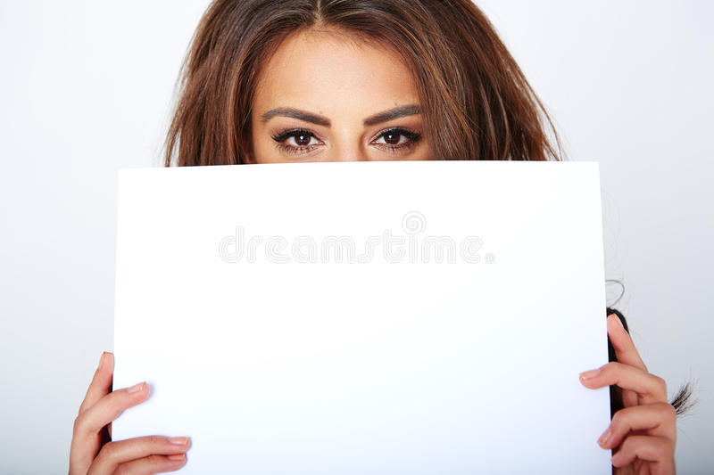Banner sign woman peeking over edge of blank empty. Paper billboard with copy space for text stock photos
