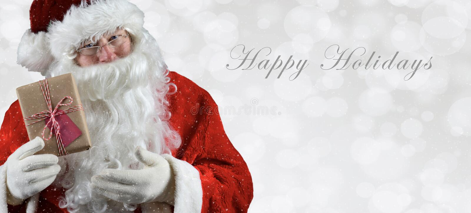 Banner sized inage with Santa Claus holding a present royalty free stock images