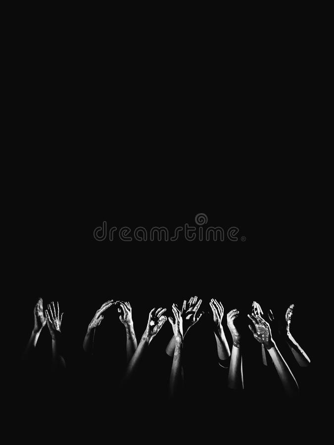Banner social concept. hands in paint raised up on a black background symbolizing fear, hope, struggle and a request for help. Pla. Ce for text, copyright stock photos