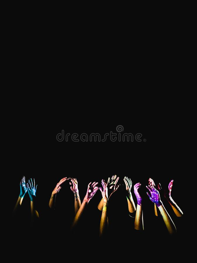 Banner social concept. hands in paint raised up on a black background symbolizing fear, hope, struggle and a request for help. Pla. Ce for text, copyright royalty free stock photography