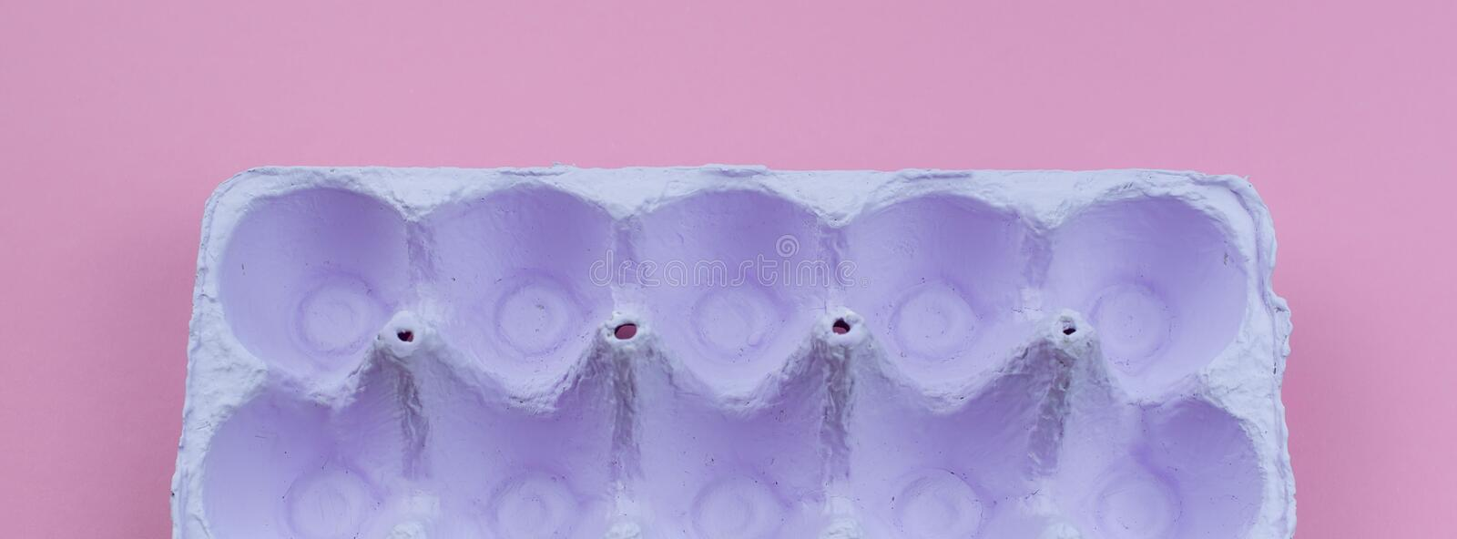 Banner Stand for eggs purple on a pink background. royalty free stock images