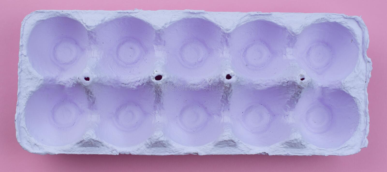 Banner Stand for eggs purple on a pink background. stock images