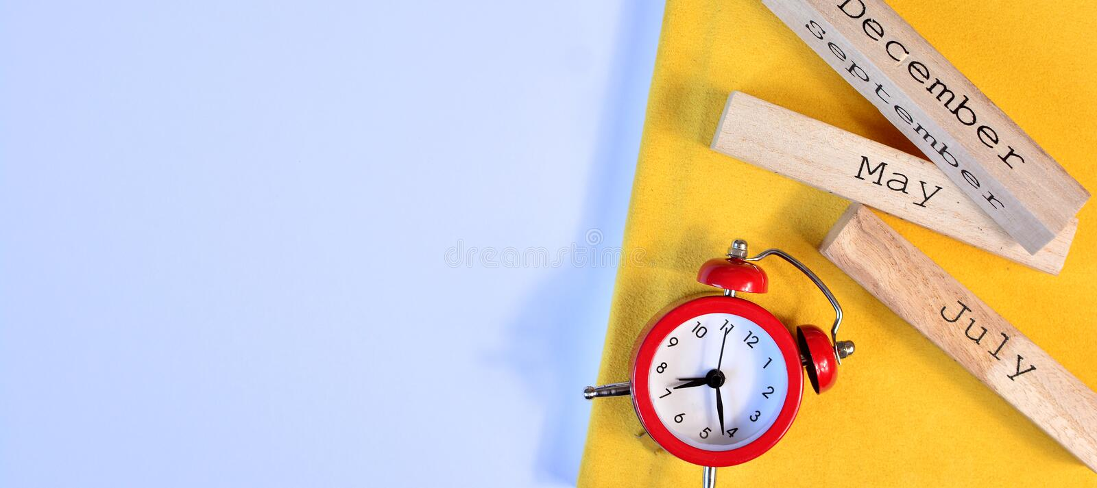 Banner template with red alarm clock and wooden calendar. Studying and learning concept. Banner template with red alarm clock and wooden calendar. Studying and stock image
