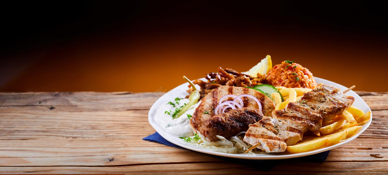 Banner with traditional Greek mixed grill platter stock photography