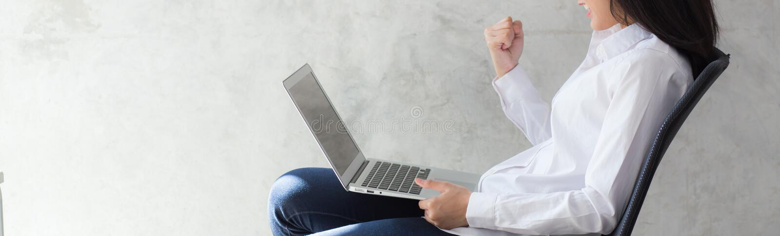 Banner website beautiful asian young woman excited and glad of success with laptop stock images