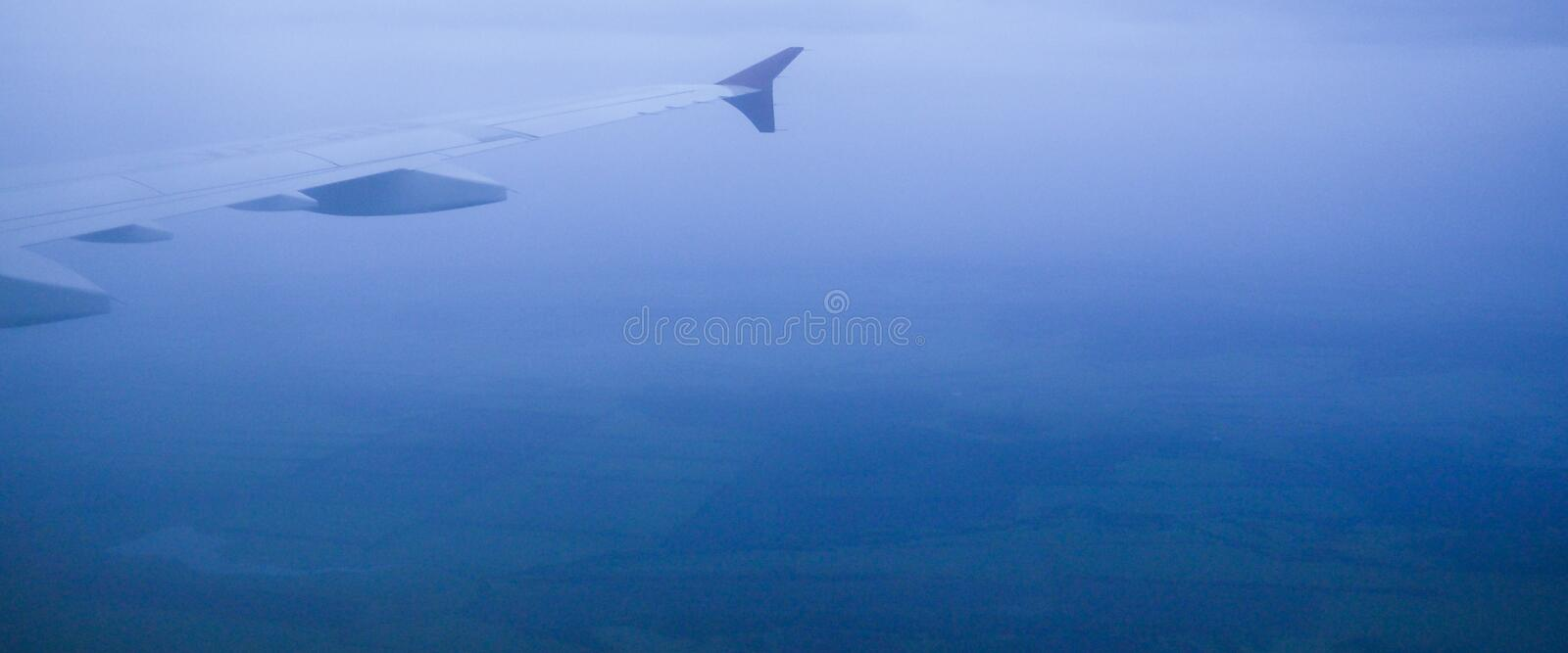 banner for website, View of jet plane wing with cloud patterns in the fog stock photography