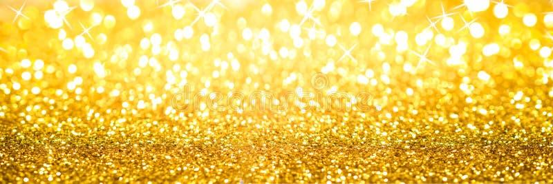 Bannière d'or de fond de scintillement image stock