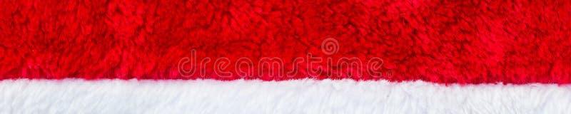 Bannière de fin vers le haut de texture rouge et blanche de chapeau de Santa Claus au backround images stock