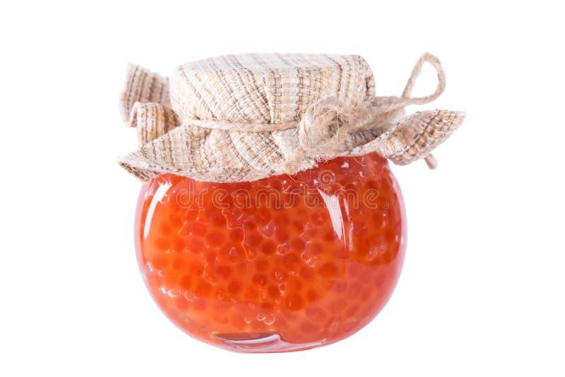 Banque de caviar rouge sur un blanc photographie stock