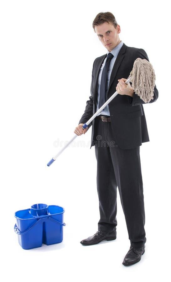 Banqueiro ou homem de negócios com cubeta e espanador fotos de stock