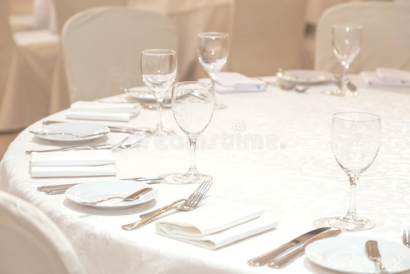 Banquet hall. Beautiful restaurant. Laid table. Table setting. Restaurant interior. Preparing to feast stock images