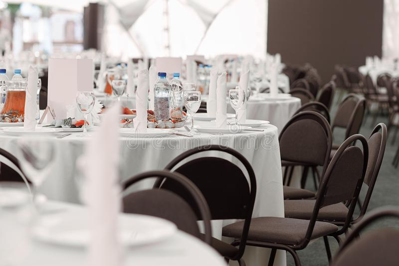 Banquet hall of a modern restaurant before the celebration. Banquet hall of a modern restaurant before the holiday royalty free stock photo