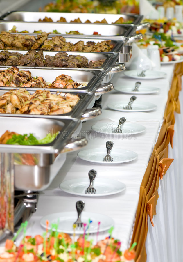 Banquet meals served on tables stock image