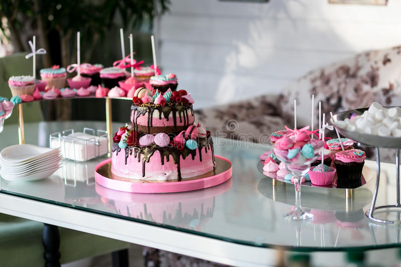 Banquet table for a banquet in a restaurant.chic pink cake, kids cake, birthday cake, sweet table,candy bar,. Banquet table for a banquet in a restaurant.chic royalty free stock image