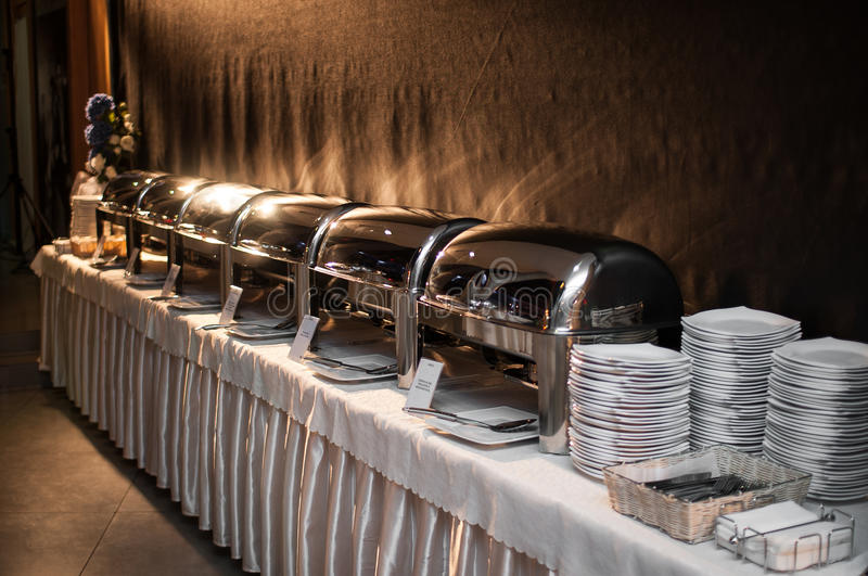 Banquet table - chafing dish heater stock images