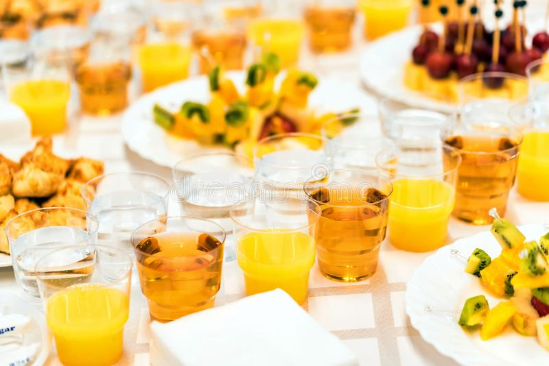 Banquet table with snacks and drinks close stock images