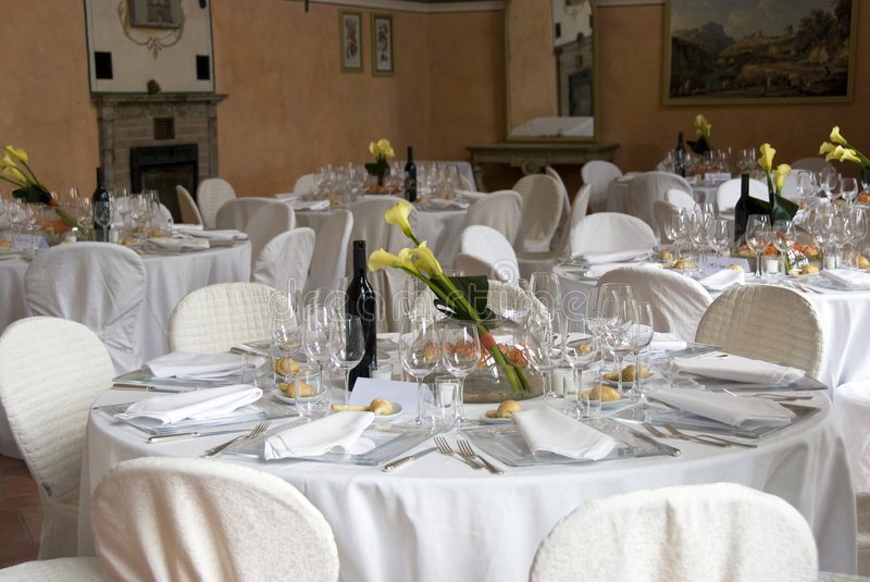 Banquet tables. Elegant banquet tables prepared for a wedding or a party royalty free stock images