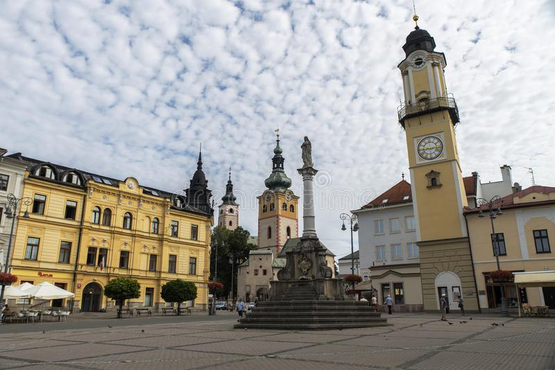 Banska Bystrica, Slovakia. SNP square with Marian Column, Clock Tower and Town Castle in Banska Bystrica, Slovakia 3.8.2017 stock photography