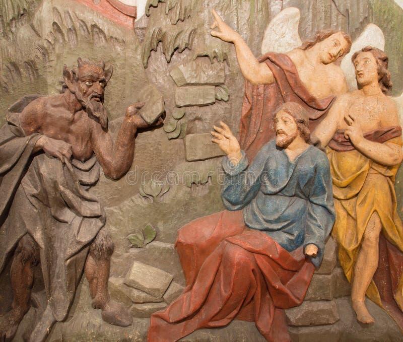 Banska Stiavnica - η χαρασμένη ανακούφιση του πειρασμού του Ιησού στην έρημο ως μέρος μπαρόκ Calvary στοκ φωτογραφία με δικαίωμα ελεύθερης χρήσης