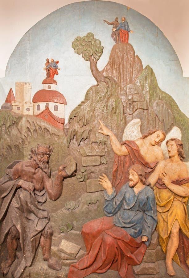 Banska Stiavnica - η χαρασμένη ανακούφιση του πειρασμού του Ιησού στην έρημο ως μέρος μπαρόκ Calvary στοκ εικόνα με δικαίωμα ελεύθερης χρήσης