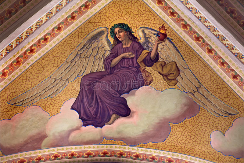 Banska Stiavnica - The angel with the hart with the flames on the ceiling of parish church from year 1910 by P. J. Kern. BANSKA STIAVNICA, SLOVAKIA - FEBRUARY 5 royalty free stock photography