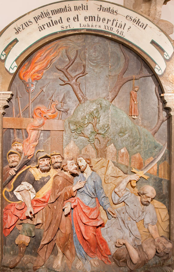 Banska Stiavnica - The carved relief of Betrayal of Judas as the part of baroque Calvary from years 1744 - 1751. BANSKA STIAVNICA, SLOVAKIA - FEBRUARY 5, 2015 stock images
