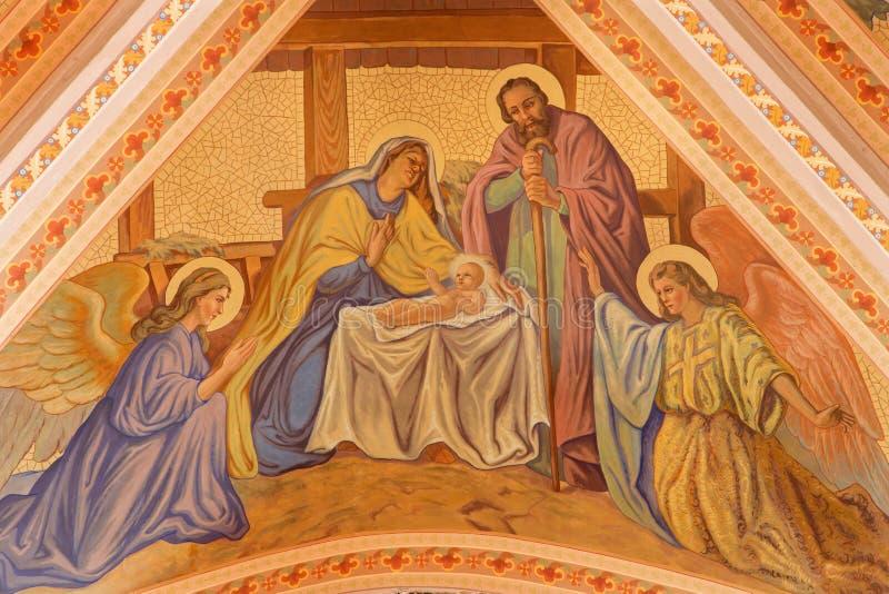 Banska Stiavnica - de fresko van Geboorte van Christusscène op het plafond van parochiekerk van jaar 1910 door P J kern stock afbeeldingen