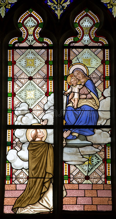 Banska Stiavnica - holy Mary and the monk. Windowpane from st. Katharine church stock images