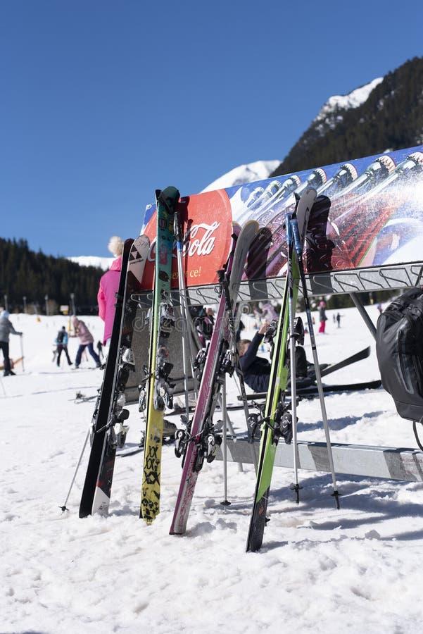 Bansko, Bulgaria, April 03, 2018: Bansko ski station, Kolarski ski lift. Skies at Bunderishka polyana, skiers on ski slopes, stock photo
