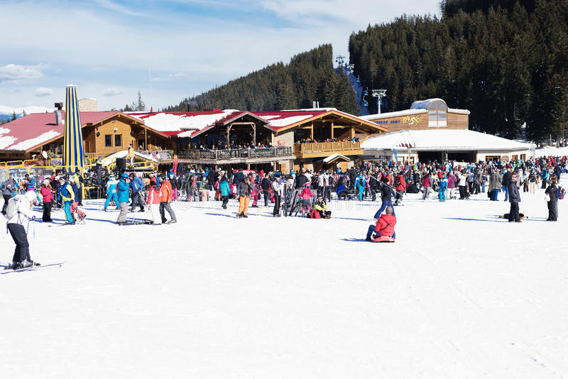 Bansko, Bulgaria, January 27, 2016: Bansko ski station, cable car lift and people waiting in line near it in Bansko, Bulgaria. Sn stock photos