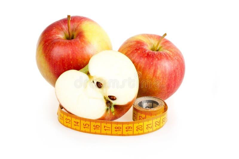 banta mätande band för äpplebegrepp fotografering för bildbyråer