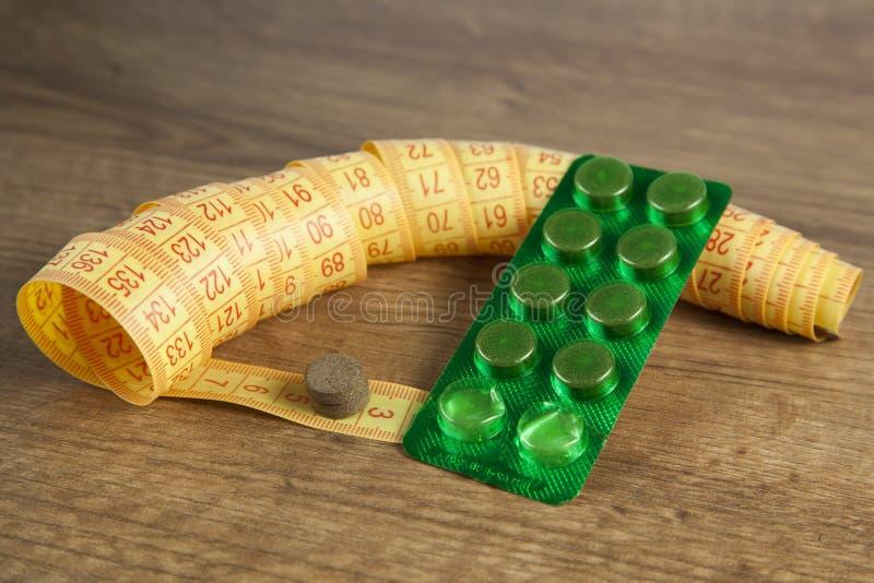 Download Banta Pills Och En Måttband Arkivfoto - Bild av bantning, magert: 27275124