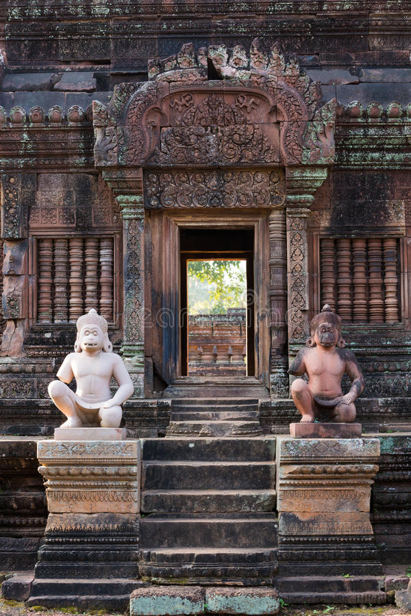 Banteay Srei doorway. Intricate carvings and statues adorn part of Banteay Srei temple in Cambodia royalty free stock photos