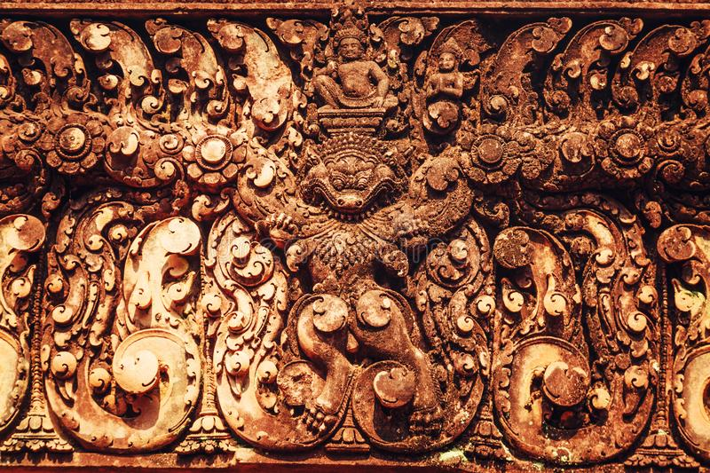 Banteay Srei - unique temple of pink sandstone. Thread fragments. Banteay Srei - unique temple of pink sandstone. Angkor, Siem Reap, Cambodia. Thread fragments royalty free stock images