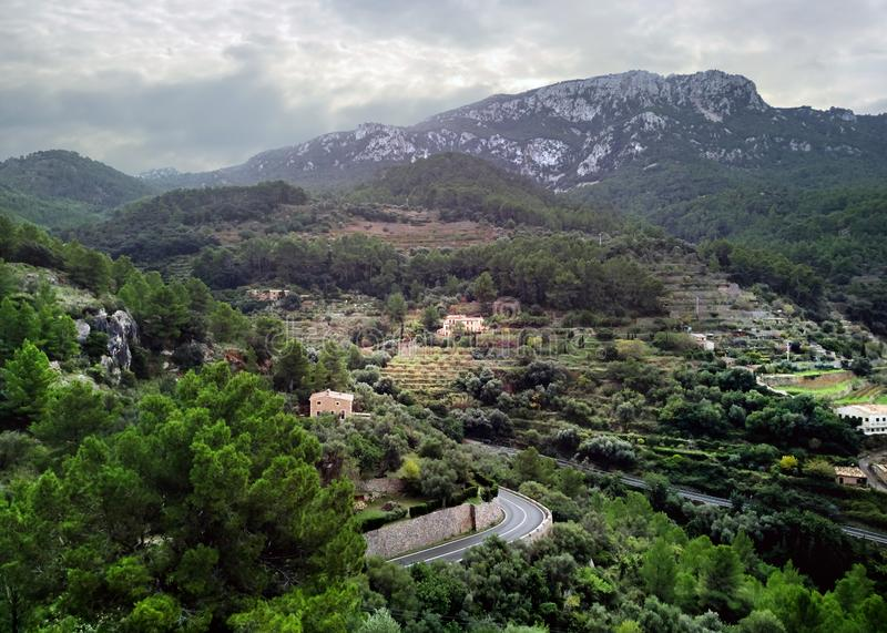 Banyalbufar town surrounded by Tramuntana mountains. Majorca, Spain stock photography
