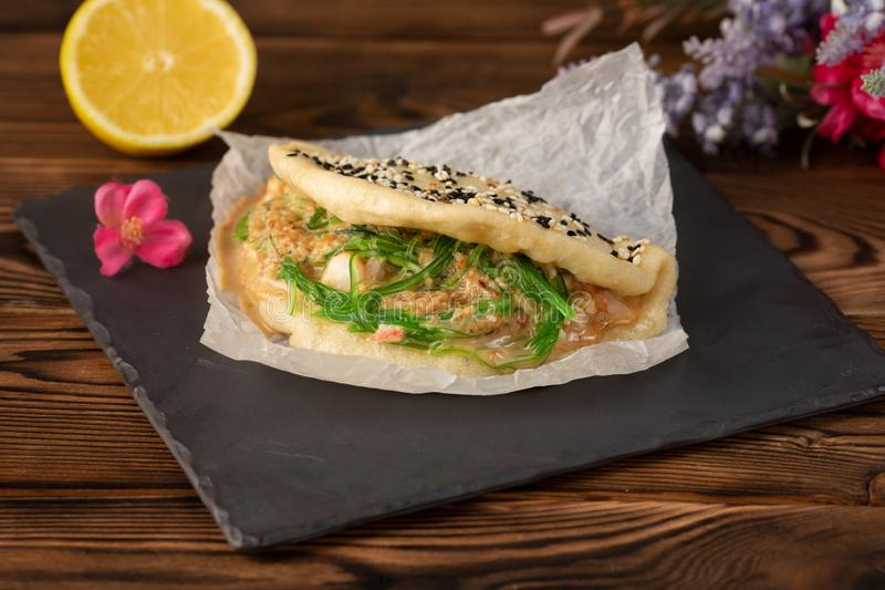 Bao with chiken on a wooden background royalty free stock photos