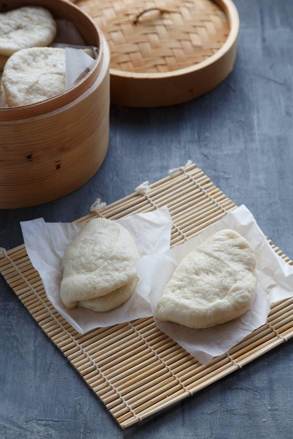 Bao de Gua, bollos cocidos al vapor en el vapor de bambú, bollos del bao foto de archivo