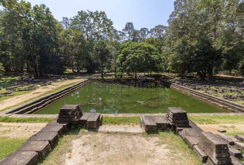 Baphuon tempelpöl i Angkor Thom, den sista och mest bestående huvudstaden av en khmervälden cambodia skördar siem arkivfoto