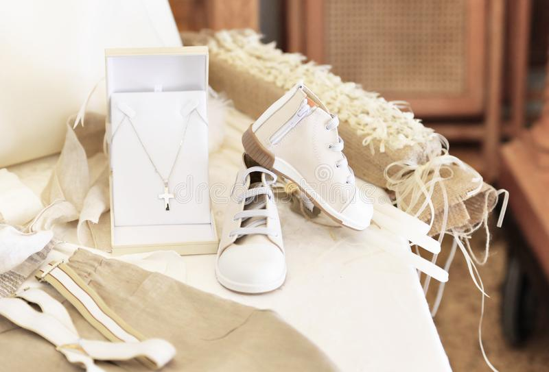 Baptism baby clothes and cross stock image
