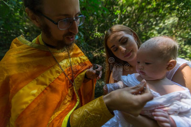 During Baptism - Christian sacrament of spiritual birth. KOH CHANG, THAILAND - MAR 10, 2018: During Baptism - Christian sacrament of spiritual birth. There are stock photography