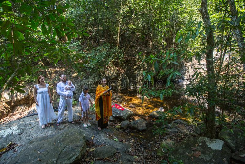 During Baptism - Christian sacrament of spiritual birth. KOH CHANG, THAILAND - MAR 10, 2018: During Baptism - Christian sacrament of spiritual birth. There are stock photo