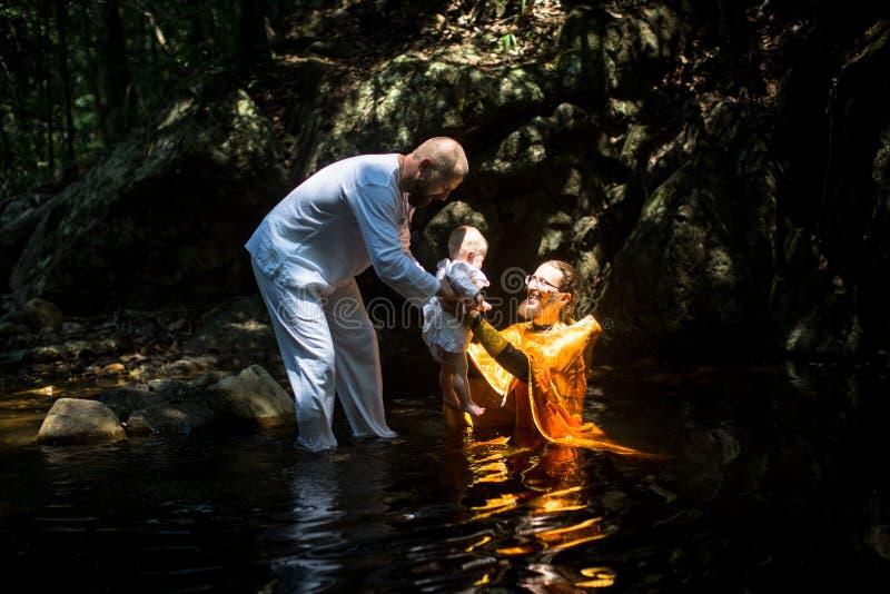 During Baptism - Christian sacrament of spiritual birth. KOH CHANG, THAILAND - MAR 10, 2018: During Christian sacrament of spiritual birth - Baptism. There are stock photography