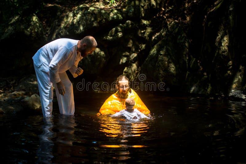 During Baptism - Christian sacrament of spiritual birth. KOH CHANG, THAILAND - MAR 10, 2018: During Christian sacrament of spiritual birth - Baptism. There are stock photos