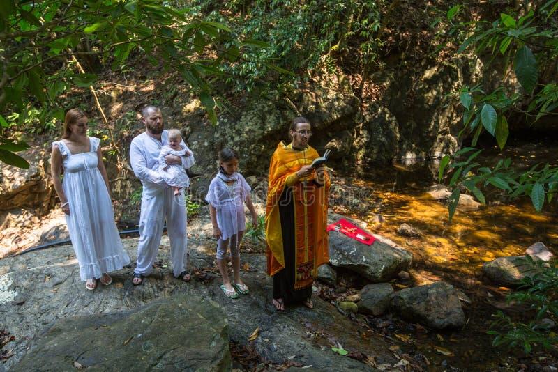 During Baptism - Christian sacrament of spiritual birth. KOH CHANG, THAILAND - MAR 10, 2018: During Baptism - Christian sacrament of spiritual birth. There are stock images
