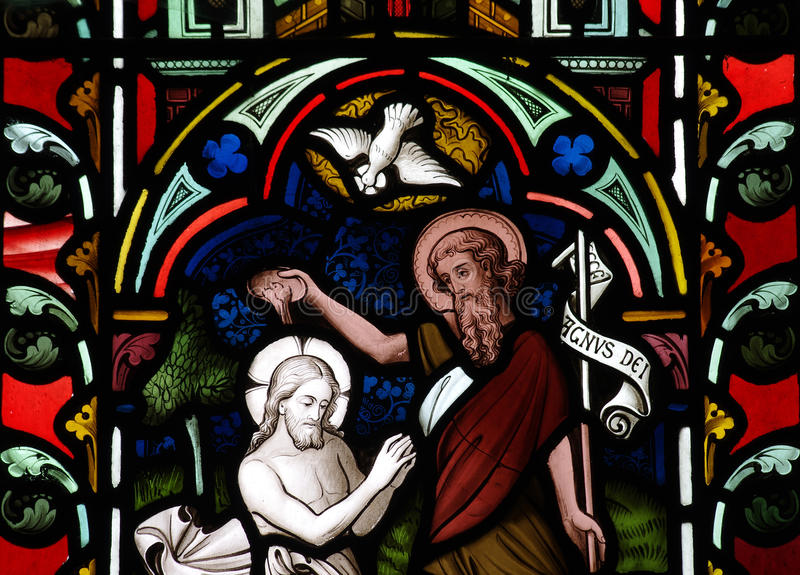 The baptism of Jesus Christ in stained glass. A photo of the baptism of Jesus Christ in stained glass royalty free stock photo