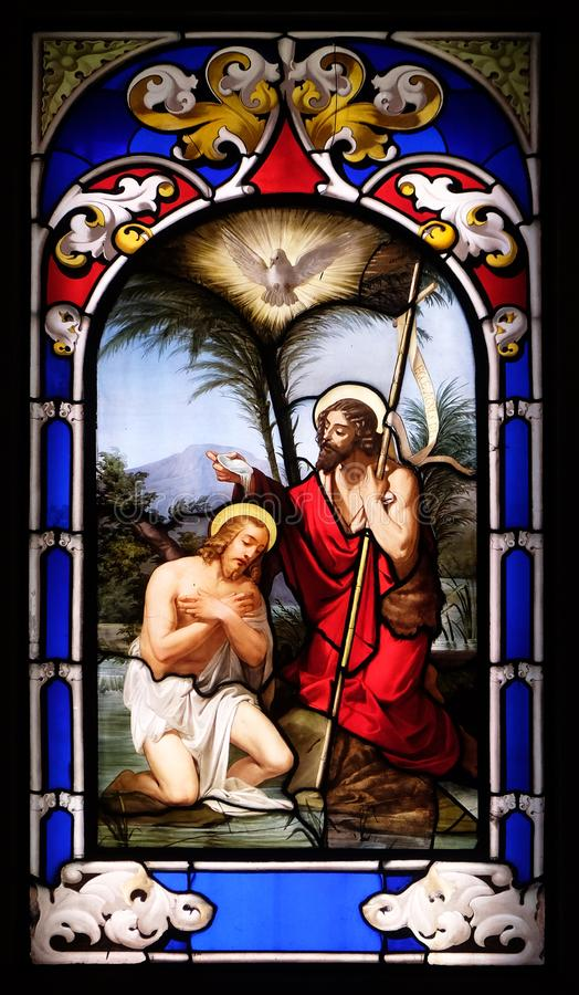 Baptism of the Lord. Stained glass window in the Church of St. Ambrose and Theodulus, Stresa, Lago Maggiore, Piedmont, Italy royalty free stock photography