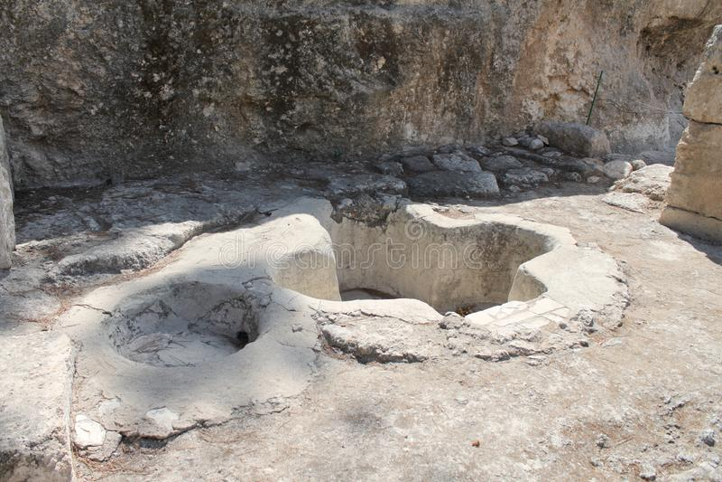 Baptismal Font, Emmaus Nicopolis, Israel. Baptismal Font Ancient christian baptismal font in cross shape at Emmaus Nicopolis, near Latrun, Israel stock image