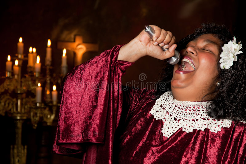 Baptist singer. Negro spiritual gospel singer singing a hymn royalty free stock photo